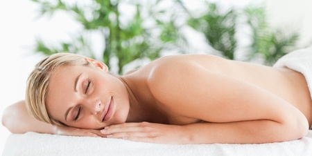 Good looking blonde woman sleeping on a lounger in a wellness center photo