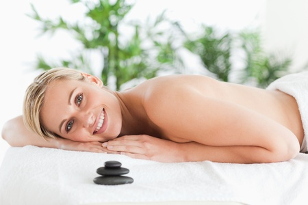 Good looking blonde woman lying on a lounger in a wellness center photo