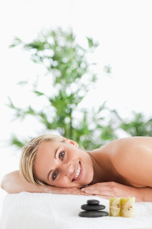 Smiling blonde woman lying on a lounger in a wellness center photo
