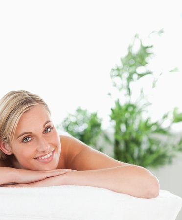 Close up of a blonde smiling woman lying on a lounger in a wellness center photo