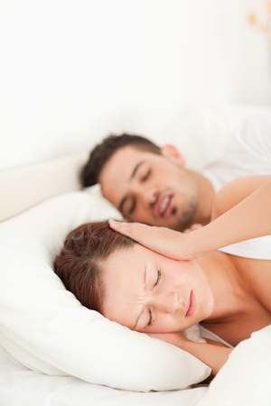 Woman not able to sleep because of snoring in the bedroom photo