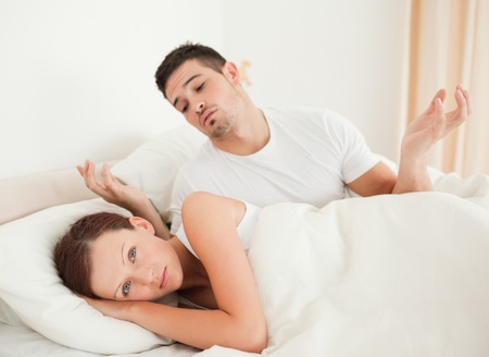clueless: Handsome Man being clueless in the bedroom Stock Photo