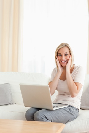 Portrait of a happy woman with a laptop looking at the camera photo