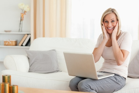Happy woman with a laptop looking at the camera photo