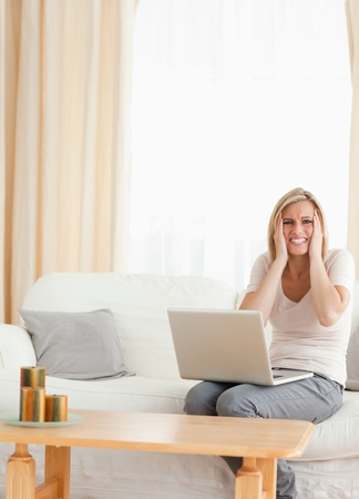 Portrait of an upset woman with a laptop looking at the camera Stock Photo - 11225310