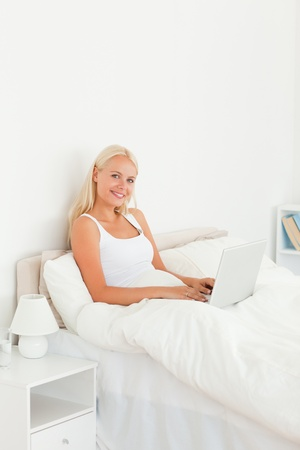 Portrait of a woman with a notebook in her bedroom Stock Photo - 11207319