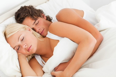 calm down: Quiet couple hugging while sleeping in their bedroom