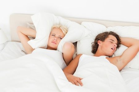 Young couple waking up in their bedroom photo