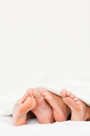 Portrait of four feet in a bed Stock Photo - 11206490