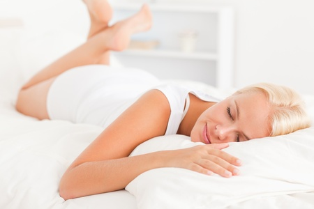 Lovely woman sleeping on her bed Stock Photo - 11207644