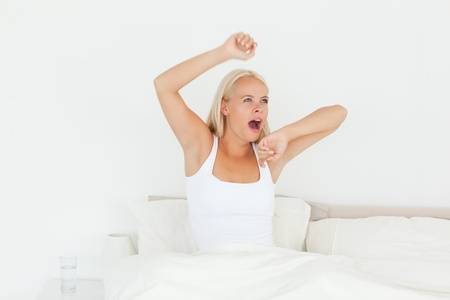 Woman waking up in her bedroom photo