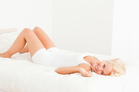 Dreaming woman lying on her back looking at the camera Stock Photo - 11206504