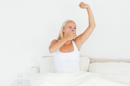 Beautiful woman waking up in her bedroom Stock Photo - 11206750