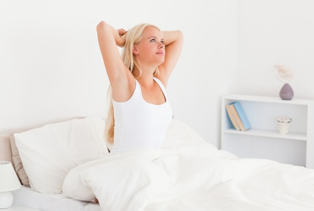 Serene woman waking up in her bedroom photo
