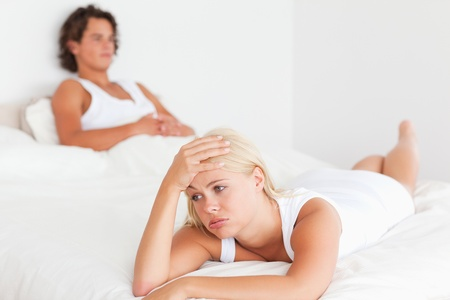 Upset young couple on their bed photo