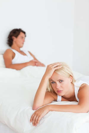 Portrait of an upset couple on their bed photo