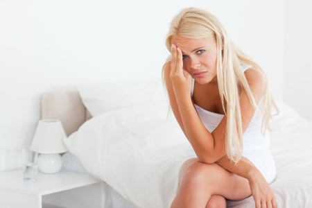 Sick blonde woman looking at the camera Stock Photo - 11232965