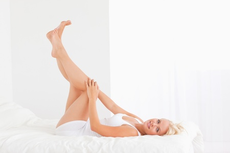 hair treatment: Beautiful woman with the legs up looking at the camera