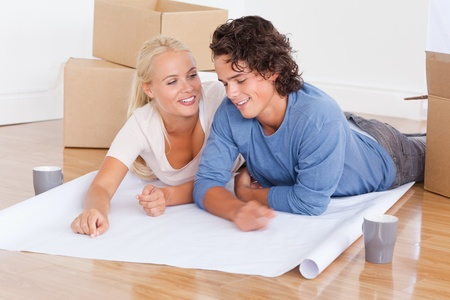 Couple moving in a new house lying on the floor Stock Photo - 11227069