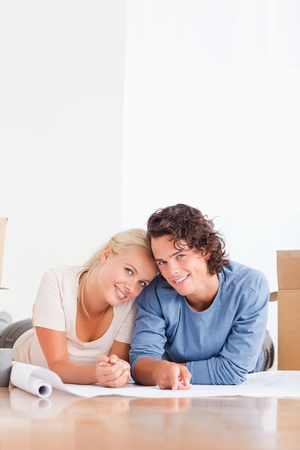 Portrait of a couple organizing their future home while looking at the camera Stock Photo - 11231808