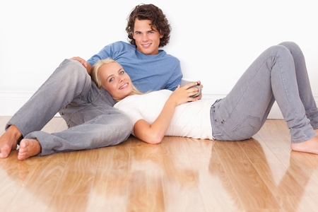 Young couple sitting together on the floor photo
