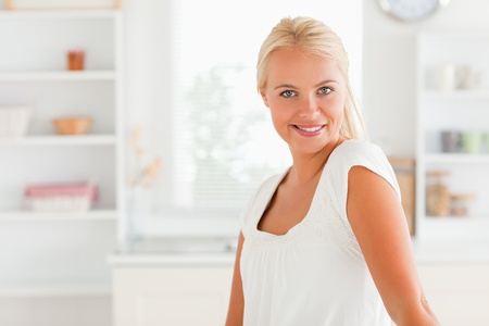 Smiling woman posing in her kitchen photo