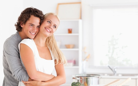 Lovely couple posing in their kitchen photo