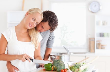 Lovely couple cooking in their kichen photo
