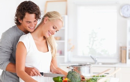 modern love: Cute couple cooking in their kitchen Stock Photo