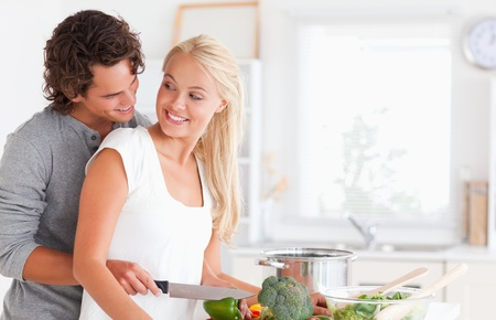 In love couple cooking in their kitchen photo