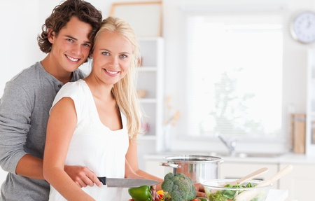 In love young couple cooking in their kitchen photo