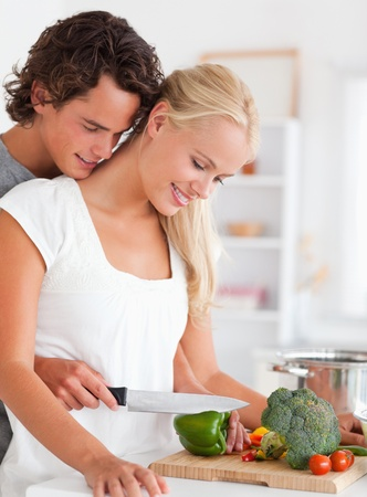 Portrait of a young couple cooking in their kitchen photo
