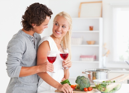 Couple having a glass of red wine while looking at each other photo