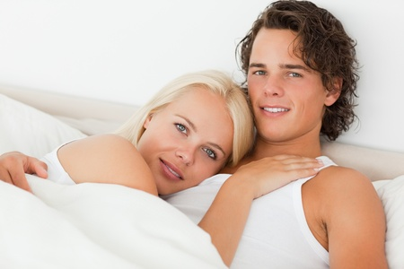 day bed: Couple in their bed looking at the camera
