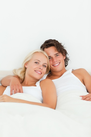 Portrait of a couple posing in their bedroom while looking at the camera Stock Photo - 11225691