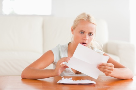 Woman having an unpleasant surprise in her living room photo