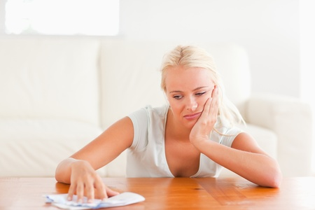 Sad woman with a letter in her living room photo