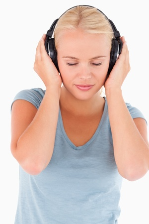 Close up of a woman with headphones in a studio Stock Photo - 11192348