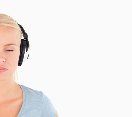 Close up of a charming woman with headphones in a studio Stock Photo - 11206241