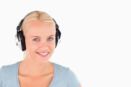 Close up of a smiling woman with headphones in a studio Stock Photo - 11206423
