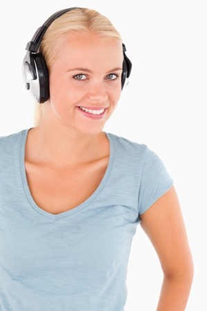 Portrait of a smiling woman with headphones in a studio photo
