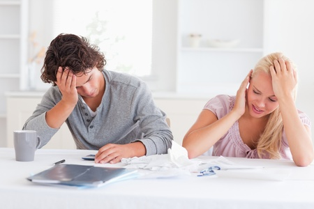 Couple in great despair in their living room photo