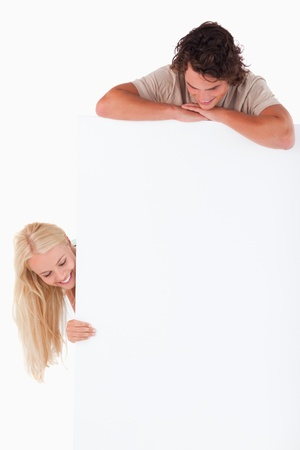 Man and woman looking at a whiteboard in a studio photo