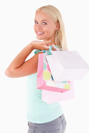 Close up of a Joyful woman with some shopping bags in a studio photo