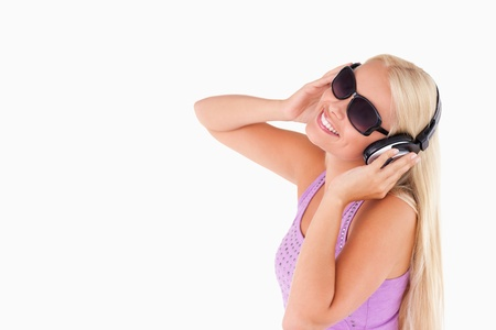 Charming woman with earphones and sunglasses in a studio Stock Photo - 11206390