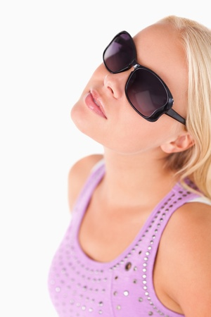 Charming lady with sunglasses in a studio photo