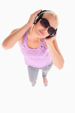 Glorious lady with sunglasses and earphones in a studio Stock Photo - 11206411