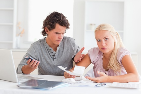 Clueless couple accounting in their living room photo
