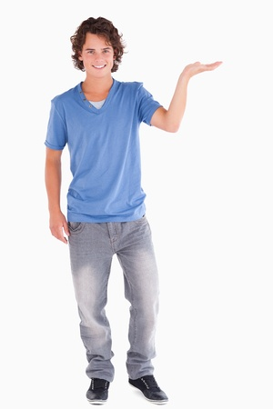 Handsome guy showing copyspace in a studio Stock Photo - 11206656