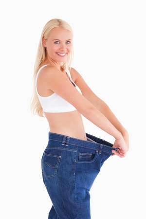 Woman wearing jeans in too big  a size photo
